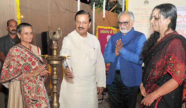 """The Minister of State for Culture (I/C) and Environment, Forest & Climate Change, Dr. Mahesh Sharma lighting the lamp to inaugurate the """"Deep Dharohar"""", Ministry of Culture's function to celebrate Deepawali, in New Delhi."""