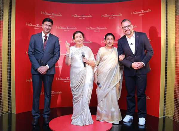 Anshul Jain, General Manager, Merlin Entertainments India and Marcel Kloos, Director New Openings Europe and Emerging markets with Asha Bhosle with Madame Tussauds figure