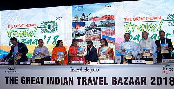 Rajasthan Chief Minister, Ms. Vasundhara Raje releasing the 'FICCI-Yes Bank Report on India Inbound Tourism: Decoding Strategies for Next Stage of Growth' at the inaugural session of GITB 2018. On her right Ms. Jyotsna Suri,  Mr. N.C. Goel,  Mr. Dipak Deva and on her left Ms. Rashmi Verma, Mr. Subodh Agarwal, Mr. Randhir Vikram Singh and Mr. Pradeep Kumar Borar.