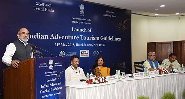 The Minister of State for Tourism (I/C), Shri Alphons Kannanthanam addressing at the launch of the Indian Adventure Tourism Guidelines, in New Delhi. The Joint Secretary, Ministry of Tourism,  Shri Suman Billa (IAS), The Secretary, Ministry of Tourism, Smt. Rashmi Verma, ATOAI President, Shri. Swadesh Kumar and other dignitaries are also seen.