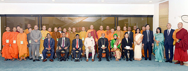 "The President, Shri Ram Nath Kovind in a group photograph at the inauguration of the ""International Buddhist Conclave- 2018"". The Minister of State for Tourism (I/C), Shri Alphons Kannanthanam, the Ambassador of Japan to India, Mr. Kenji Hiramatsu, the Secretary, Ministry of Tourism, Smt. Rashmi Verma and other dignitaries are also seen."