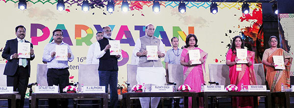 The Union Home Minister, Mr. Rajnath Singh releasing the event calendar at the inauguration of the countrywide Paryatan Parv. The Minister of State for Tourism (I/C), Mr. Alphons Kannanthanam, Secretary (MoT) Smt. Rashmi Verma, Director General (MoT) Mr. Satyajeet Rajan, Addl. D.G, Smt. Meenakshi Sharma, Joint Secretary (MoT) Mr. Suman Billa and other dignitaries are also seen.