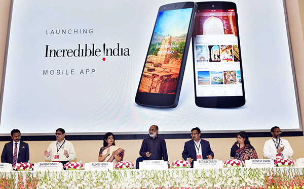 "The Minister of State for Tourism (I/C), Mr. Alphons Kannanthanam launching the ""Incredible India"" mobile app"