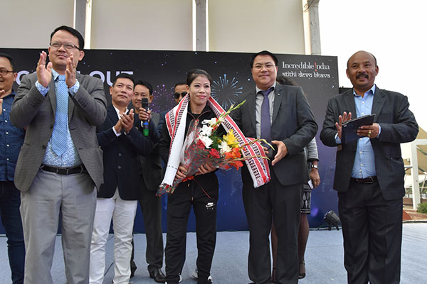 Mr. W. Ibohal Singh (MCS), Director (Tourism), Govt. of Manipur felicitating MC Mary Kom